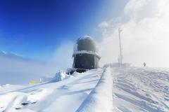 Ice-covered screen weather station, high on mountain-top Kuvituskuvat