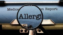 Magnifying glass on medical report allergies Stock Footage