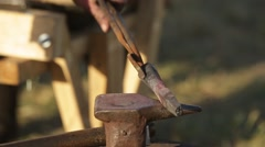 Blacksmith forges a spear on the anvil Stock Footage