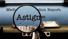 Magnifying glass on medical report astigmatism Stock Footage
