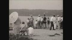 Pan of people at beach in Newport RI 1930 Stock Footage