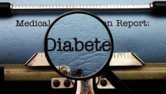 Magnifying glass on diabetes medical report Stock Footage