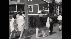 Horribles Parade passing onlookers July 4th 1931 - stock footage