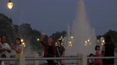 Girls making selfie  at fountain in Huai Wang Nong,Ubon Ratchathani,Thailand Stock Footage