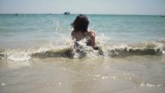 Young woman relaxing and sunbathing, slow motion 240fps Stock Footage