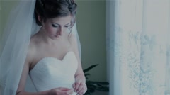 The bride wears a wedding accessory - stock footage