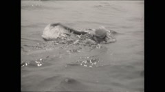 Woman swimming in open water Stock Footage