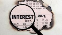 Magnifying glass on interest rates Stock Footage