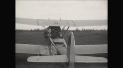 Pilot Boards Bi Plane 1930 Stock Footage