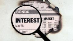 Magnifying glass on interest rates - stock footage