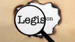 Magnifying glass on legislation paper hole Stock Footage