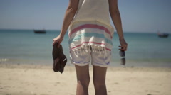 Stock Video Footage of Woman with sandals and sunglasses standing on beach, slow motion 240fps