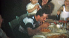 1951: Big family at crowded dinner table eat Italian food. - stock footage