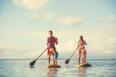 Family Stand Up Paddling - stock photo