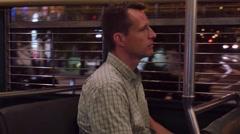 Man Rides San Francisco Streetcar at Night   - stock footage