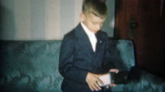 1951: Boy shows money from first wallet in formal suit dress. Stock Footage