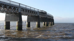 Tay Rail Bridge at high tide with choppy water Dundee Scotland Stock Footage