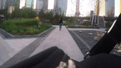 Stalker is following woman through the Park, camera hidden in the bag Stock Footage