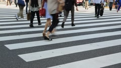 Pedestrians walking at zebra crossing in Shinjuku, Tokyo, Japan - stock footage