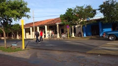 Blue oldsmobile cruising through quiet street in small town of Viñales, Cuba Stock Footage