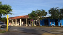 Policemen in white Lada passing through quiet street of town Viñales, Cuba - stock footage