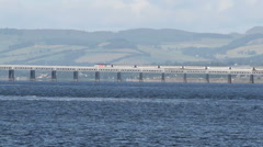 Virgin Train crossing Tay Rail Bridge Dundee Scotland Stock Footage