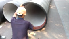 Chinese workers install steel pipes, urban water supply facilities - stock footage
