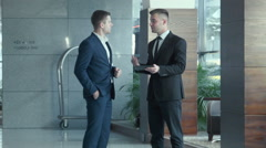 Dialogue of two businessmen - stock footage