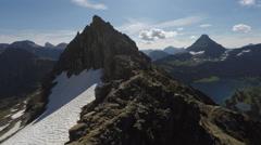 Aerial rocky mountain peaks - stock footage