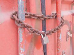 Chain Lock Shipping Container - stock photo
