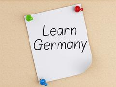 Stock Illustration of 3d Learn Germany, word on post-it over cork.