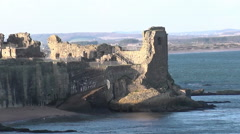 Zooming out from St Andrews Castle Fife Scotland Stock Footage