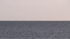 Zooming out from Bell Rock Lighthouse Scotland Stock Footage