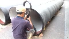 Chinese workers install steel pipes, urban water supply facilities Stock Footage