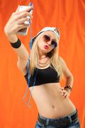 Sexy hip hop girl photographed themselves on the phone Stock Photos