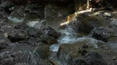 Small river streaming in rocky river bed Stock Footage