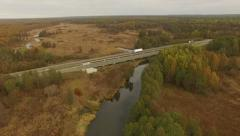 4K aerial view – flight over highway with river and colorful autumn forests Stock Footage