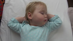 Lovely baby sleeping arms crossed Stock Footage