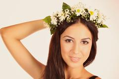 Gorgeous young women with beautiful chaplet flowers on isolated background Stock Photos