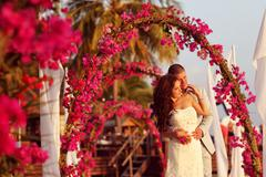 Beautiful bride and groom getting married on tropic island of Maldives Stock Photos