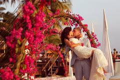 Beautiful bride and groom getting married on tropic island of Maldives - stock photo