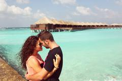 Stock Photo of Beautiful couple on their honeymoon in tropical island of Maldives