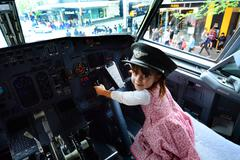 Little child fly a Boeing 737 Stock Photos