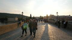 Walking on Karlův most at sunset in Prague Stock Footage