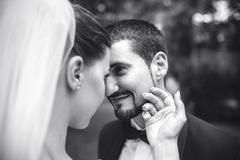 beautiful bride caress gently, the groom's face - stock photo