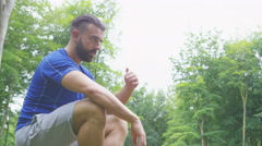 4K Young fit man working out in the woods - stock footage