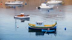 Kalkara, Malta - JULY 23, 2015: Boatman near national maltese bout luzzu in m Stock Footage
