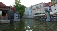 Two outdoor restaurants next to Certovka water channel, Prague Stock Footage