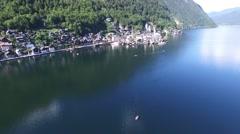 Hallstatt mountain village and alpine lake, Austrian Alps Stock Footage