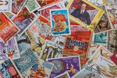 background from soviet  post stamps - stock photo